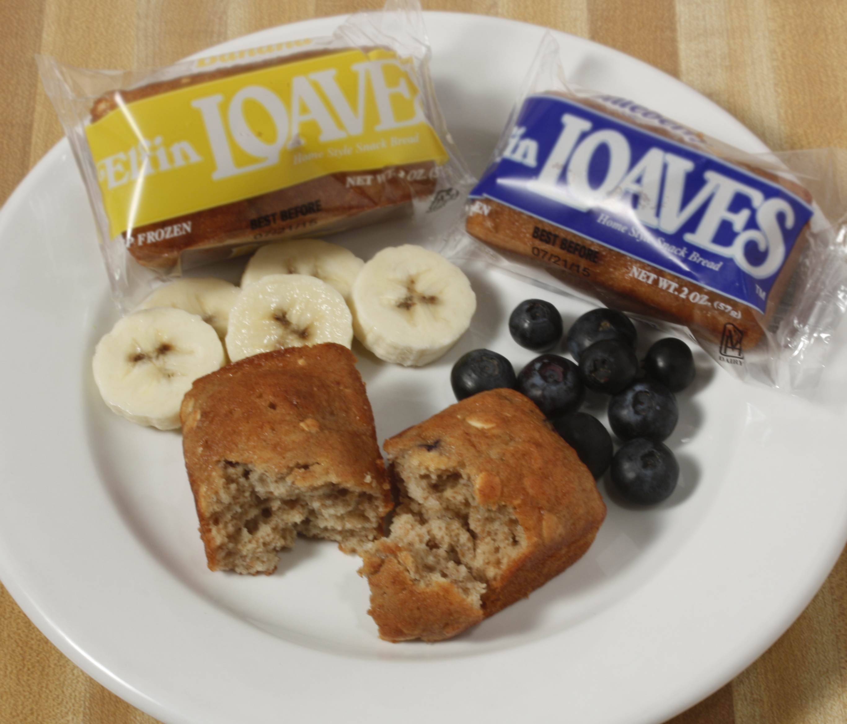 Plate of foodservice Whole Grain Banana and Blueberry Elfin Loaves in a school setting