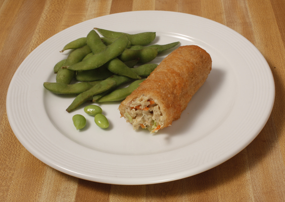 Plate of foodservice Golden Tiger Asian Vegetable Egg Roll with Snap Peas in a school setting
