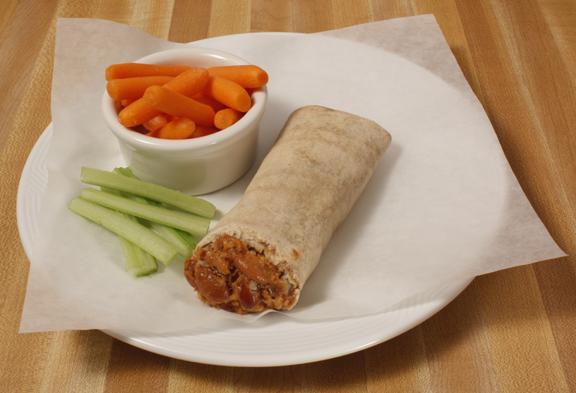 Plate of foodservice Posada Mexican Bean and Cheese Burrito with Carrots and Celery in a school setting