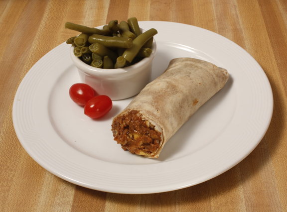 Plate of foodservice Posada Mexican Fiesta Bean Burrito with Green Beans in a school setting