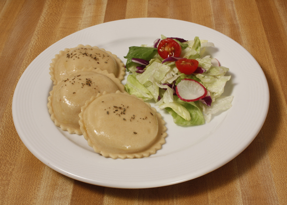 Plate of foodservice Bernardi Italian Ravioli with Salad in a school setting